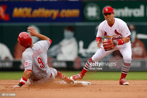 Aledmys Diaz of the St Louis Cardinals is unable to turn a double play after making an out against Jose Peraza of the Cincinnati Reds during the...