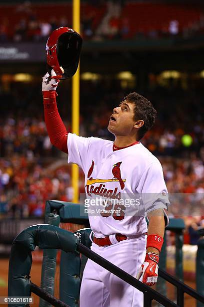 Aledmys Diaz of the St Louis Cardinals looks to the sky during a curtain call after hitting a grand slam against the Cincinnati Reds in the fourth...