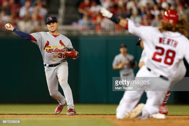 Aledmys Diaz of the St Louis Cardinals makes a throw to first base against the Washington Nationals for the third out of the sixth inning at...