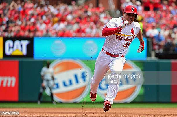 Aledmys Diaz of the St Louis Cardinals runs to third for a triple during the fourth inning against the Pittsburgh Pirates at Busch Stadium on July 7...