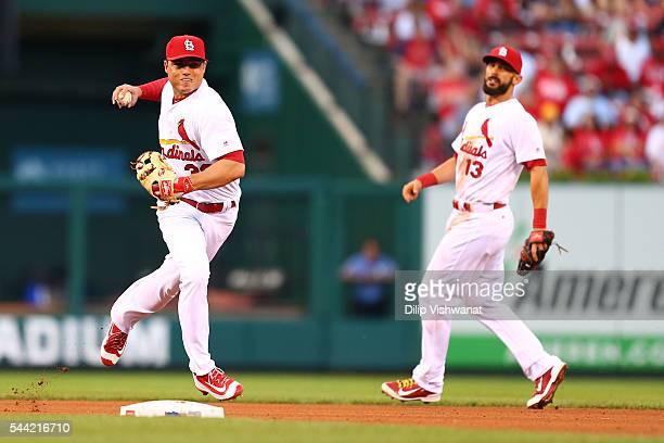 Aledmys Diaz of the St Louis Cardinals throws a runner out against the Milwaukee Brewers in the third inning at Busch Stadium on July 1 2016 in St...