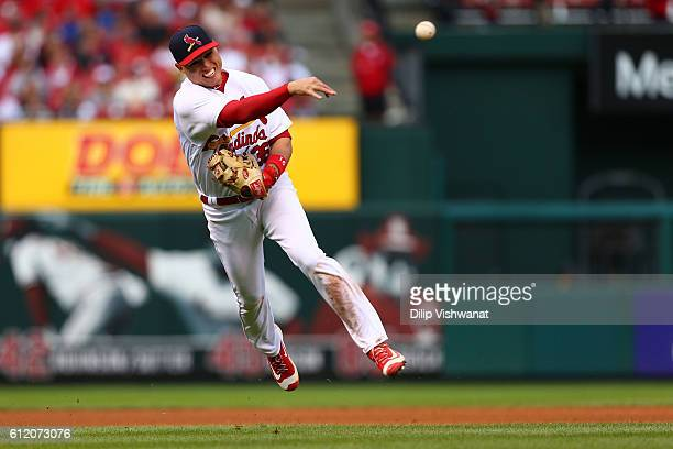 Aledmys Diaz of the St Louis Cardinals throws a runner out against the Pittsburgh Pirates in the eighth inning at Busch Stadium on October 2 2016 in...