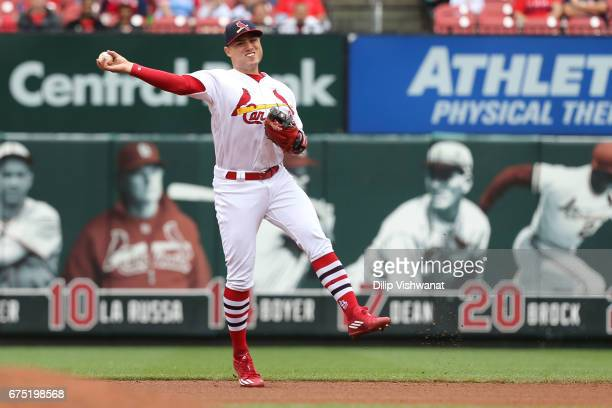 Aledmys Diaz of the St Louis Cardinals throws a runner out against the Cincinnati Reds in the fourth inning at Busch Stadium on April 30 2017 in St...