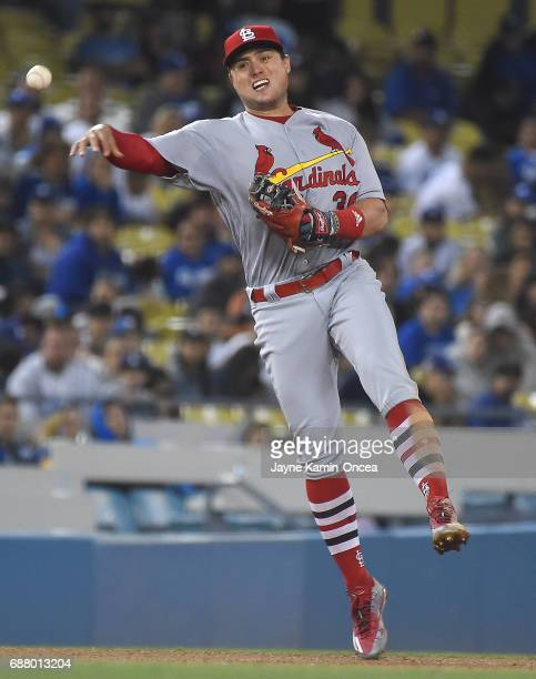 Aledmys Diaz of the St Louis Cardinals throws out Logan Forsythe of the Los Angeles Dodgers at first in the sixth inning of the game at Dodger...