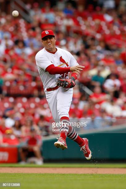 Aledmys Diaz of the St Louis Cardinals throws to first base for an out during the eighth inning against the Cincinnati Reds at Busch Stadium on June...