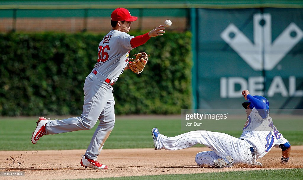 Aledmys Diaz #36 of the St. Louis Cardinals throws to first base to complete a double play after forcing out Willson Contreras #40 of the Chicago Cubs at second base during the sixth inning at Wrigley Field on September 24, 2016 in Chicago, Illinois.