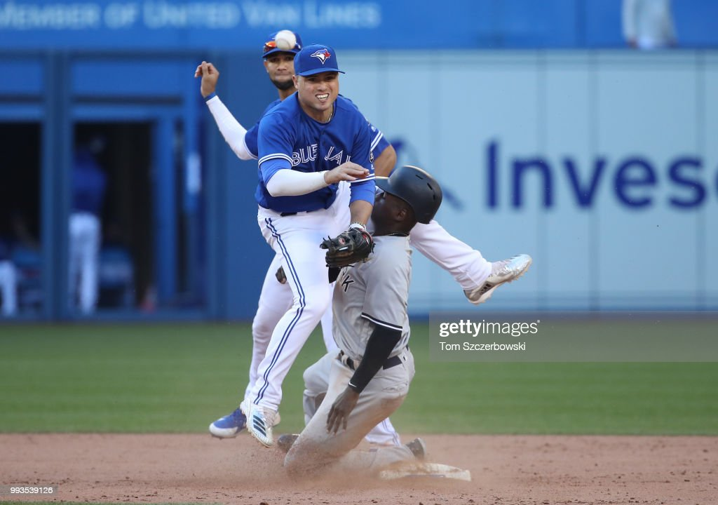 Aledmys Diaz #1 of the Toronto Blue Jays collides with Didi Gregorius #18 of the New York Yankees as Gregorius arrives at second base safely but Diaz throws out the baserunner in the ninth inning during MLB game action at Rogers Centre on July 7, 2018 in Toronto, Canada.