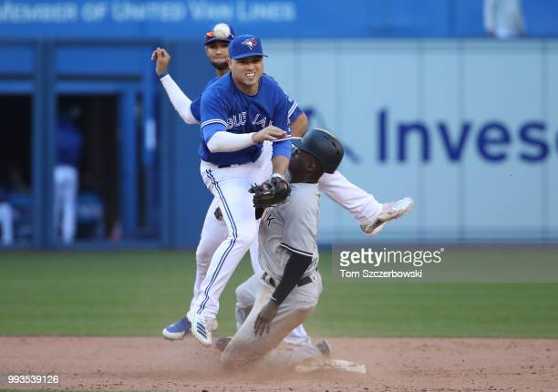 Aledmys Diaz of the Toronto Blue Jays collides with Didi Gregorius of the New York Yankees as Gregorius arrives at second base safely but Diaz throws...