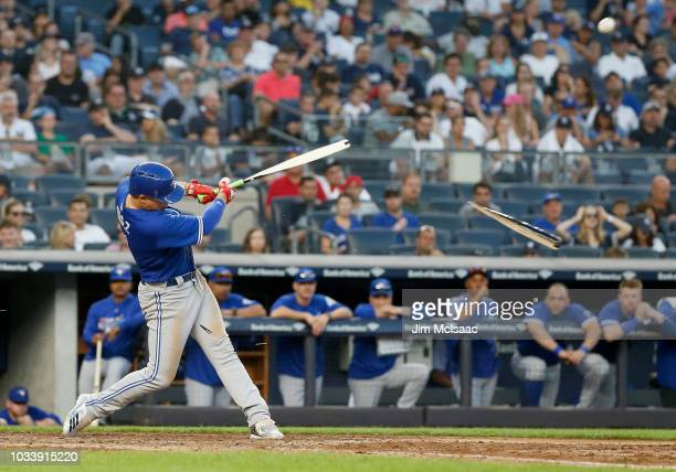 Aledmys Diaz of the Toronto Blue Jays connects on a seventh inning broken bat two run single against the New York Yankees at Yankee Stadium on...