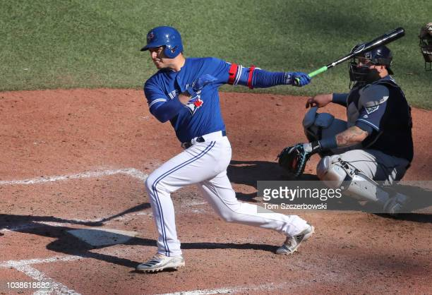 Aledmys Diaz of the Toronto Blue Jays hits an RBI single in the eighth inning during MLB game action against the Tampa Bay Rays at Rogers Centre on...