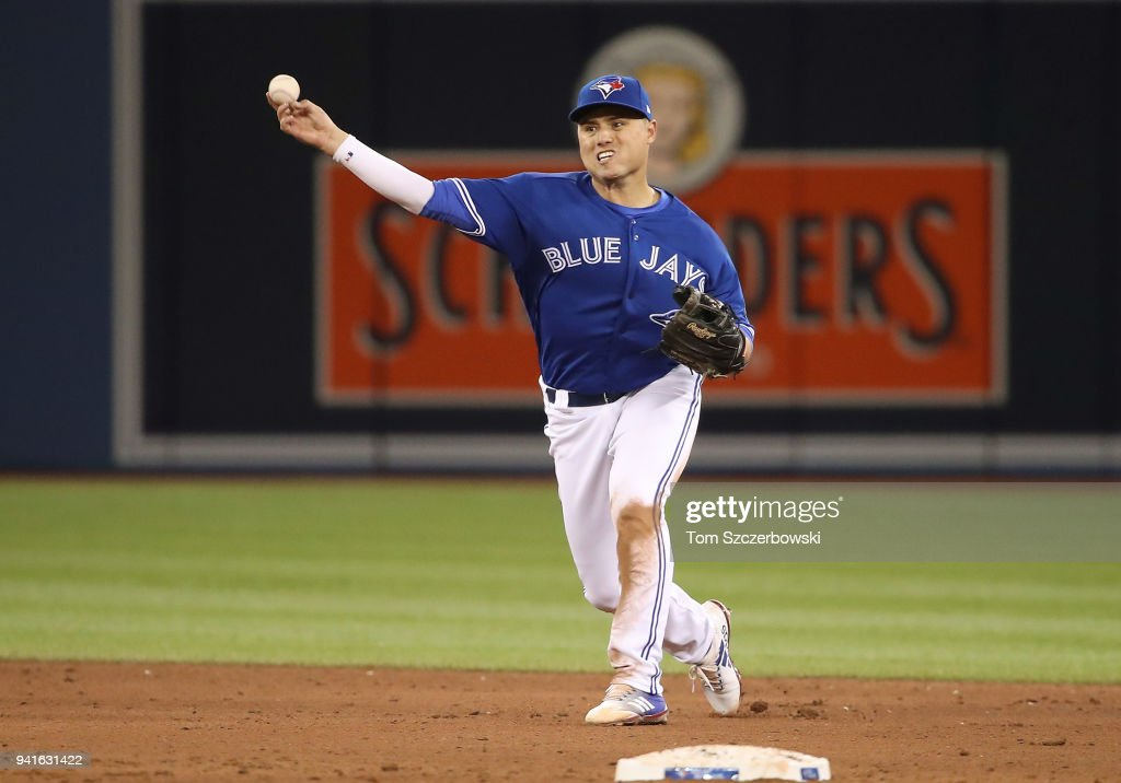 Aledmys Diaz #1 of the Toronto Blue Jays makes a throwing error in the fifth inning during MLB game action against the Chicago White Sox at Rogers Centre on April 3, 2018 in Toronto, Canada.
