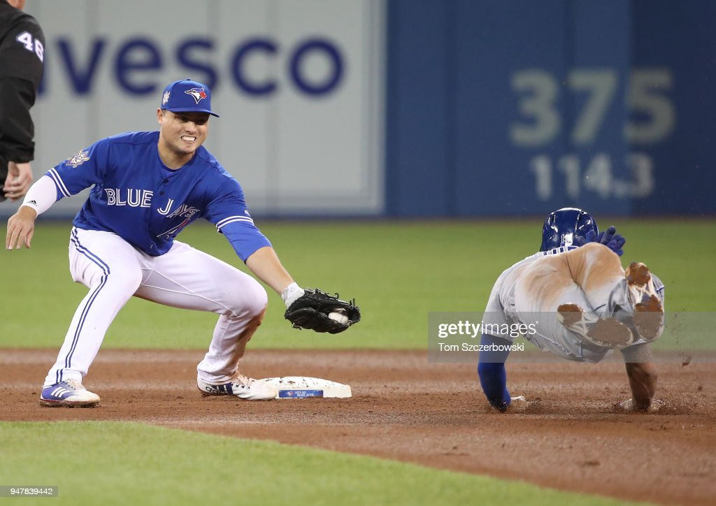 Aledmys Diaz #1 of the Toronto Blue Jays waits for Cheslor Cuthbert #19 of the Kansas City Royals to arrive at second base before tagging him out in the fourth inning during MLB game action at Rogers Centre on April 17, 2018 in Toronto, Canada.