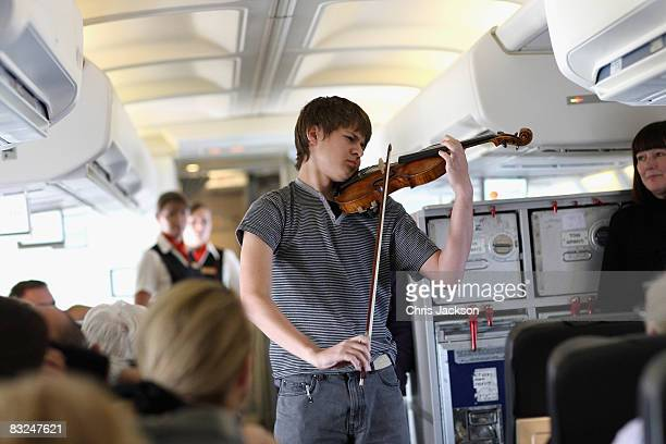 Aleem Kandour plays violin on Harvey Goldsmith's charter plane returning from a memorial concert for late opera singer Luciano Pavarotti as part of...