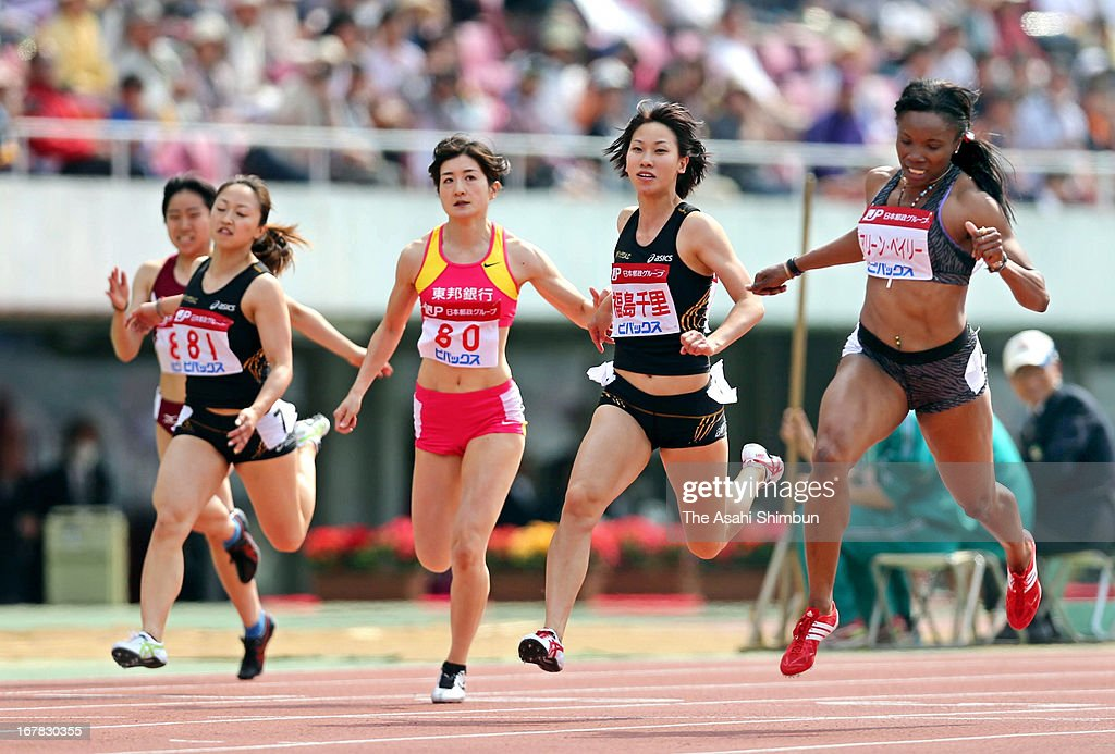 Aleen Bailey (1R) of Jamaica, Chisato Fukushima of Japan (2R) compete in the Women's 100m during the Mikio Oda Memorial Athletics Championships at Edion Stadium Hiroshima on April 29, 2013 in Hiroshima, Japan.