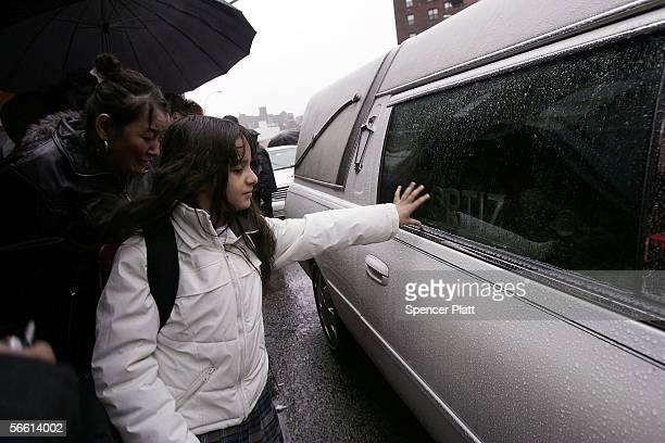 Aleena Gonzalez touches the hearse carrying the body of Nixzmary Brown after her funeral January 18 2006 in New York City Brown was found beaten to...