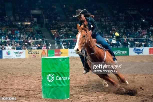 Aleeyah Roberts corners her horse while competing in the Ladies Barrel Racing competition during the MLK Jr African American Heritage Rodeo at the...