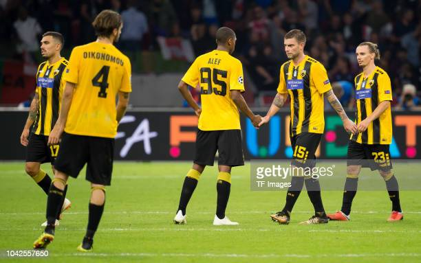 Alef of AEK Athen Uros Cosic of AEK Athen and Niklas Hult of AEK Athen look dejected after the UEFA Champions League Group E match between Ajax and...