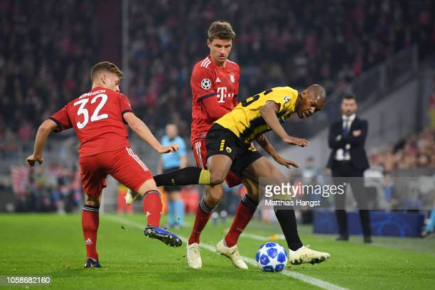 Alef of AEK Athens celebrates victory Thomas Mueller of Bayern Munich and Joshua Kimmich of Bayern Munich during the UEFA Champions League Group E...