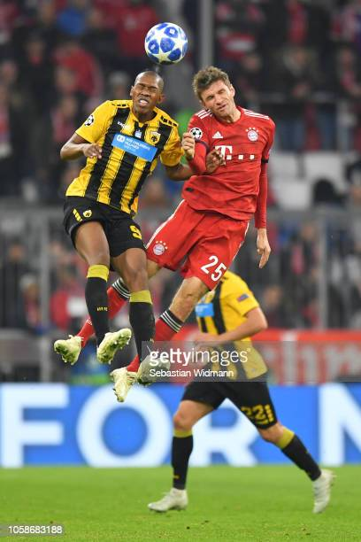 Alef of AEK Athens wins a header over Thomas Mueller of Bayern Munich during the UEFA Champions League Group E match of the between FC Bayern...