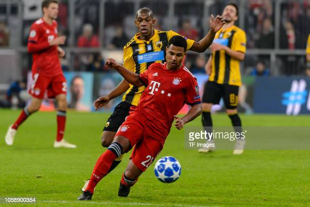 Alef Saldanha of AEK Athens and Serge Gnabry of Bayern Muenchen battle for the ball during the Group E match of the UEFA Champions League between FC...