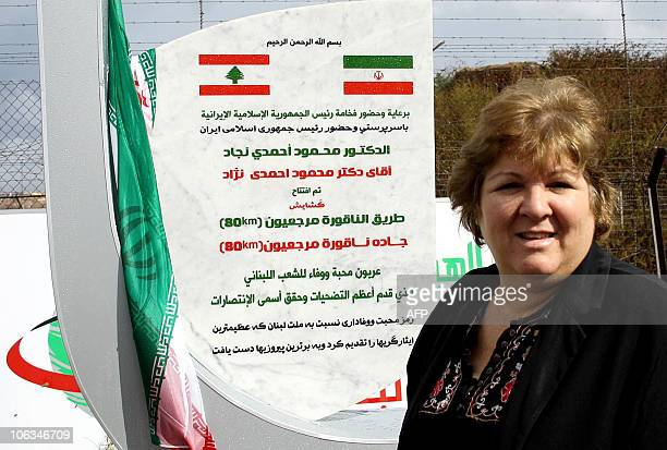 Aleida Guevara daughter of Ernesto Che Guevara poses next to a marble plaque installed near the Fatima Gate on the Lebanese Israeli border in the...