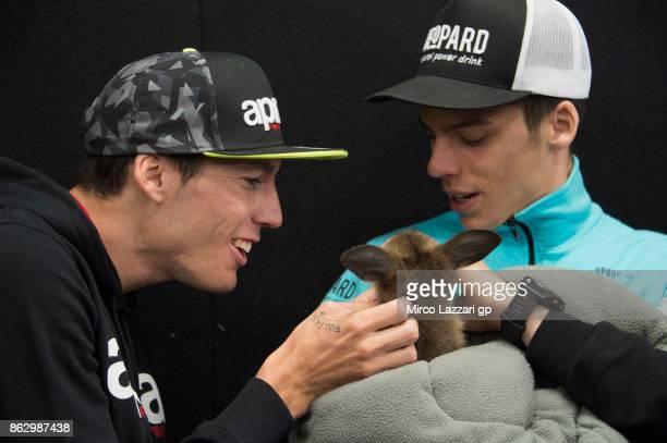 Aleix Espargaro of Spain and Aprilia Racing Team Gresini and Joan Mir of Spain and Leopard Racing joke with kangaroo during the preevent 'MotoGP...