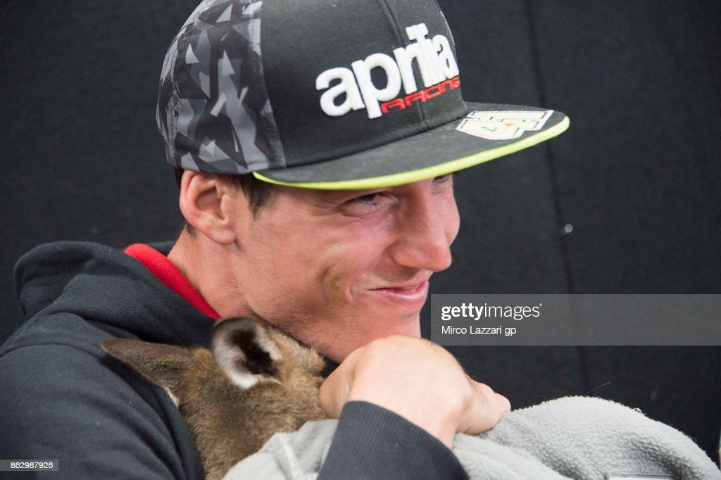 Aleix Espargaro of Spain and Aprilia Racing Team Gresini jokes with kangaroo during the pre-event 'MotoGP riders meet the australian animals' during previews ahead of the 2017 MotoGP of Australia at Phillip Island Grand Prix Circuit on October 19, 2017 in Phillip Island, Australia.