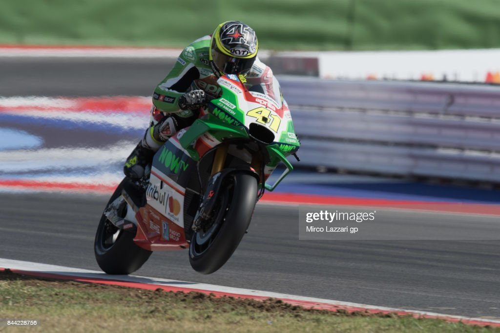 Aleix Espargaro of Spain and Aprilia Racing Team Gresini lifts the front wheel during the MotoGP of San Marino - Free Practice at Misano World Circuit on September 8, 2017 in Misano Adriatico, Italy.