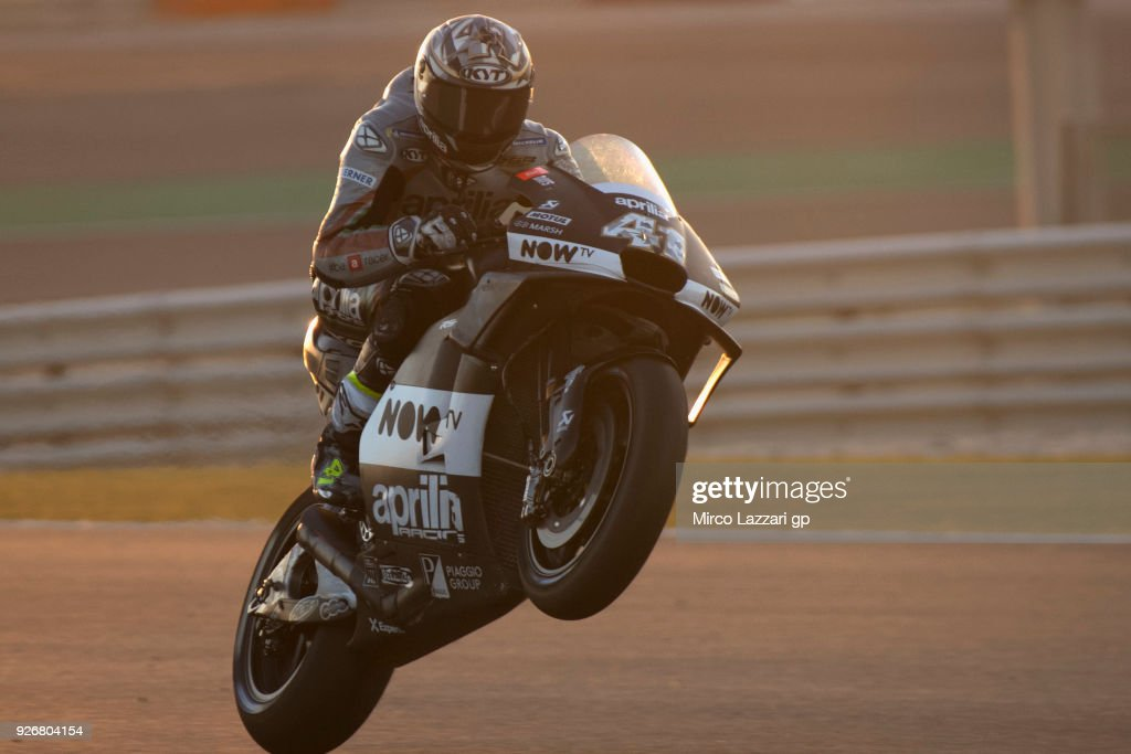 Aleix Espargaro of Spain and Aprilia Racing Team Gresini lifts the front wheel during the Moto GP Testing - Qatar at Losail Circuit on March 3, 2018 in Doha, Qatar.