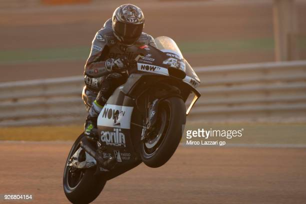 Aleix Espargaro of Spain and Aprilia Racing Team Gresini lifts the front wheel during the Moto GP Testing Qatar at Losail Circuit on March 3 2018 in...