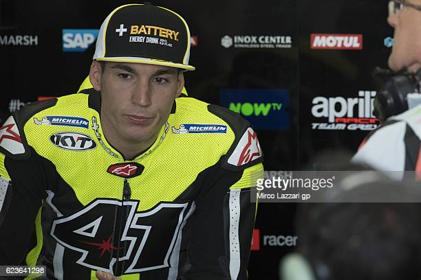 Aleix Espargaro of Spain and Aprilia Racing Team Gresini looks on in box during the MotoGp Tests In Valencia at Ricardo Tormo Circuit on November 16...