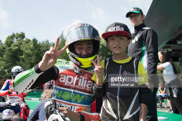 Aleix Espargaro of Spain and Aprilia Racing Team Gresini poses his teammate for this preevent race during the preevent 'The minibattle between the...