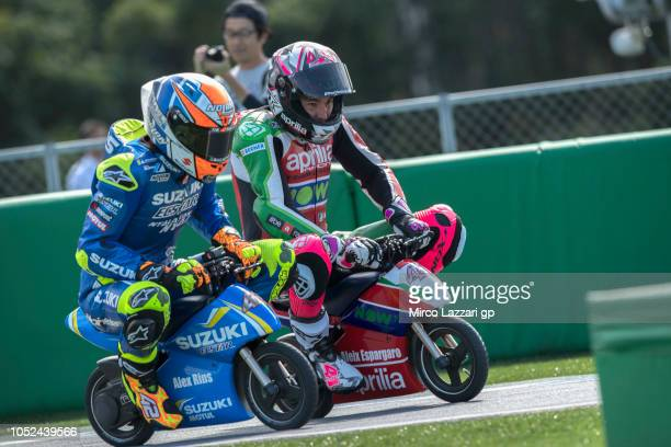 Aleix Espargaro of Spain and Aprilia Racing Team Gresini rides the minimoto and leads Alex Rins of Spain and Team Suzuki ECSTAR during the preevent...