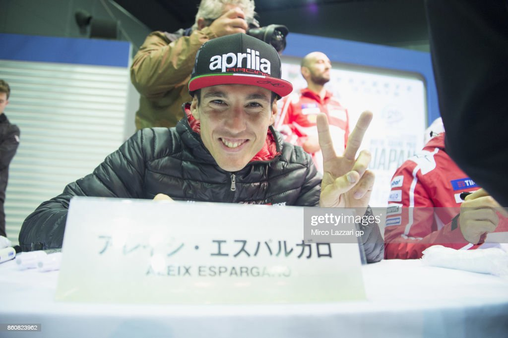 Aleix Espargaro of Spain and Aprilia Racing Team Gresini signs autographs for fans during the MotoGP of Japan - Free Practice at Twin Ring Motegi on October 13, 2017 in Motegi, Japan.