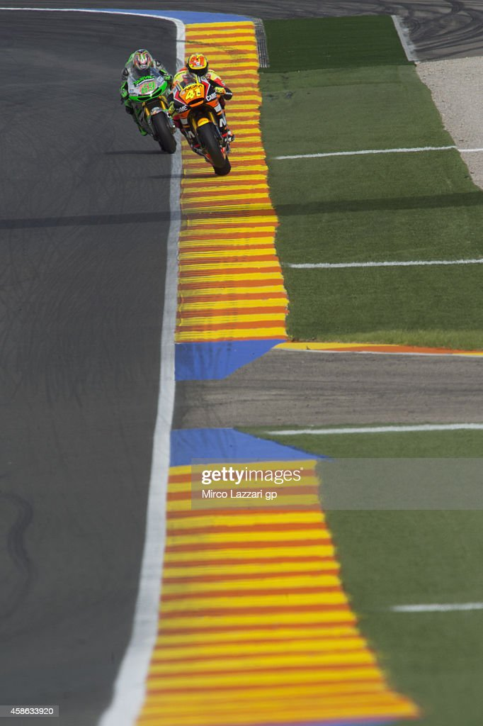 Aleix Espargaro (front) of Spain and NGM Mobile Forward Racing and Nicky Hayden of USA and Drive M7 Aspar head down a straight during the qualifying practice during the MotoGP of Valencia - Qualifying at Ricardo Tormo Circuit on November 8, 2014 in Valencia, Spain.
