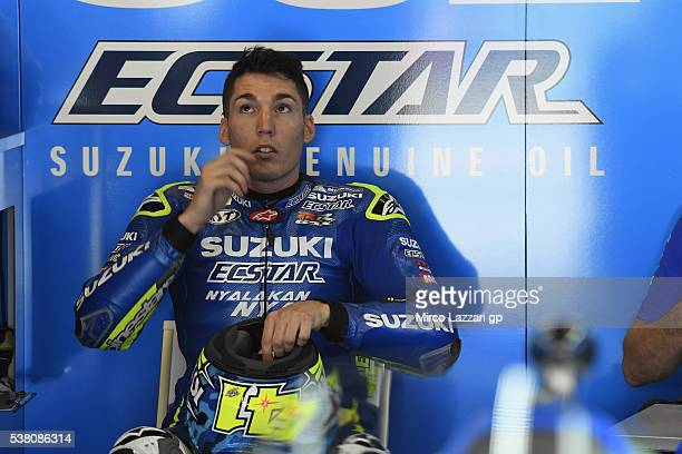 Aleix Espargaro of Spain and Team Suzuki ECSTAR looks on in box during the qualifying practice during the MotoGp of Catalunya Qualifying at Circuit...