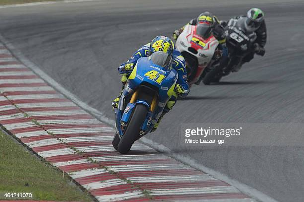 Aleix Espargaro of Spain and Team Suzuki MotoGP leads the field during the MotoGP Tests in Sepang Day One at Sepang Circuit on February 23 2015 in...