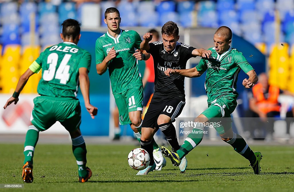 Aleix Febas of Real Madrid Academy is challenged by Veselin Lyubomirov (R) and Oleg Dimitrov of Ludogorets during the UEFA Youth Champions League match between PFC Ludogorets Razgrad and Real Madrid at Georgi Asparuhov Stadion on October 1, 2014 in Sofia, Bulgaria.