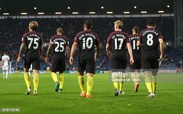 Aleix Garcia Fernandinho Sergio Aguero Kevin De Bruyne Aleksandar Kolarov and Ilkay Gundogan of Manchester City walk away during the Premier League...