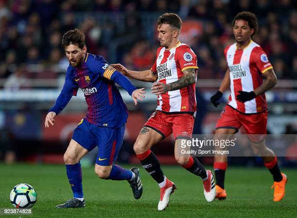 Aleix Garcia of Girona chases down Lionel Messi of Barcelona during the La Liga match between Barcelona and Girona at Camp Nou on February 24 2018 in...