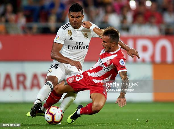 Aleix Garcia of Girona competes for the ball with Casemiro of Real Madrid during the La Liga match between Girona FC and Real Madrid CF at Montilivi...