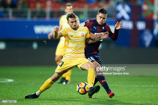 Aleix Garcia of Girona FC duels for the ball with Daniel Garcia of SD Eibar during the La Liga match between SD Eibar and Girona FC at Ipurua...