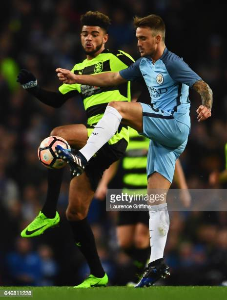Aleix Garcia of Manchester City battles with Philip Billing of Huddersfield Town during The Emirates FA Cup Fifth Round Replay match between...