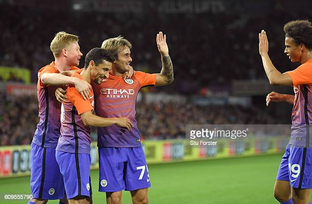 Aleix Garcia Serrano of Manchester City celebrates scoing his sides second goal with team mates during the EFL Cup Third Round match between Swansea...