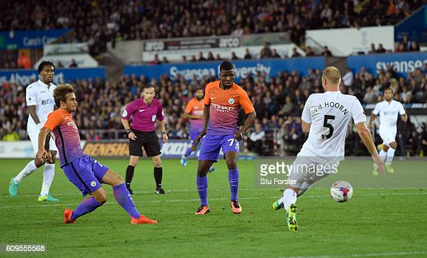 Aleix Garcia Serrano of Manchester City scores his sides second goal during the EFL Cup Third Round match between Swansea City and Manchester City at...