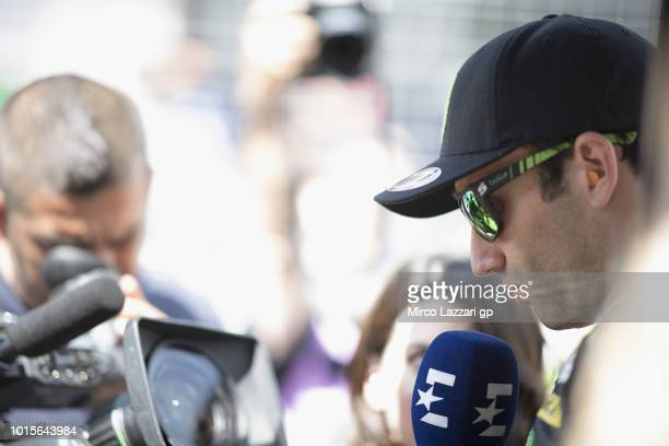 Aleix Johann Zarco of France and Monster Yamaha Tech 3 speaks with journalists and prepares to start on the grid during the MotoGP race during the...