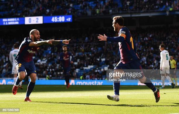 Aleix Vidal of Barcelona celebrates after scoring his sides third goal with Lionel Messi of Barcelona during the La Liga match between Real Madrid...