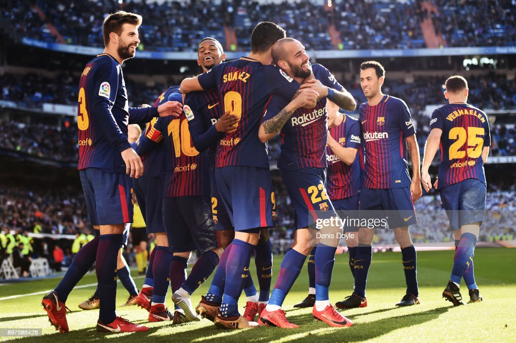 Aleix Vidal of Barcelona celebrates with his teammates after scoring his sides third goal during the La Liga match between Real Madrid and Barcelona at Estadio Santiago Bernabeu on December 23, 2017 in Madrid, Spain.