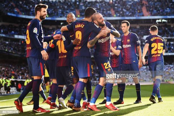 Aleix Vidal of Barcelona celebrates with his teammates after scoring his sides third goal during the La Liga match between Real Madrid and Barcelona...