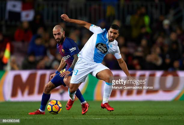 Aleix Vidal of Barcelona competes for the ball with Zakaria Bakkali of Deportivo de La Coruna during the La Liga match between Barcelona and...